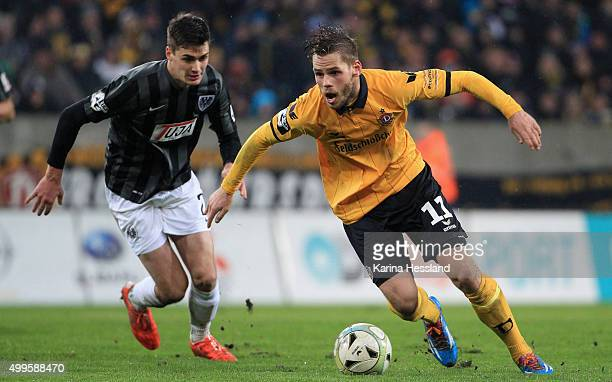 Justin Eilers of Dresden on the ball behind him Danilo Wiebe of Muenster during the Third League match between SG Dynamo Dresden and Preussen...