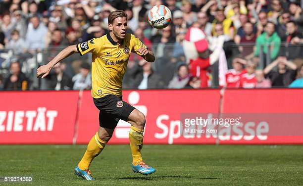 Justin Eilers of Dresden runs with the ball during the third league match between FC Energie Cottbus and SG Dynamo Dresden at Stadion der...