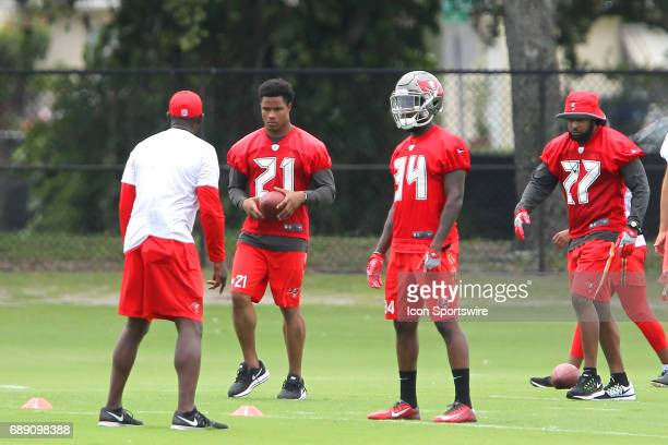 Justin Evans Alex Gray and J J Wilcox listen to their defensive coach during the Tampa Bay Buccaneers OTA on May 25 2017 at One Buccaneer Place in...