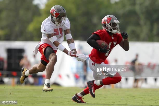 Justin Evans defends against Donteea Dye Jr as Dye carries the ball after the catch during the Tampa Bay Buccaneers Training Camp on July 29 2017 at...