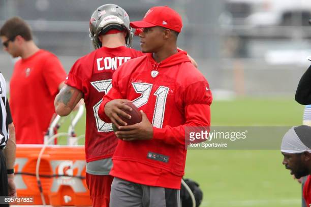 Justin Evans holds a football during the Tampa Bay Buccaneers Minicamp on June 13 2017 at One Buccaneer Place in Tampa Florida