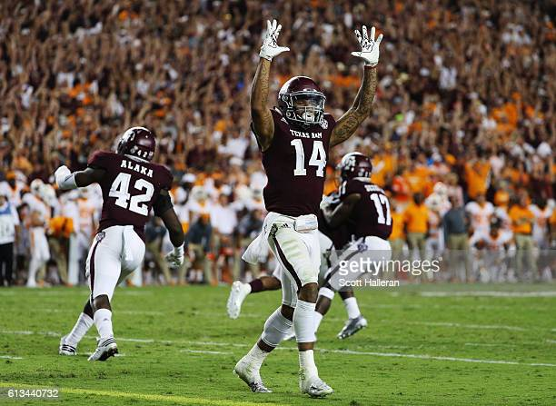 Justin Evans of the Texas AM Aggies celebrates with his teammates after the Aggies defeated Tennessee Volunteers 4538 in the second overtime of their...