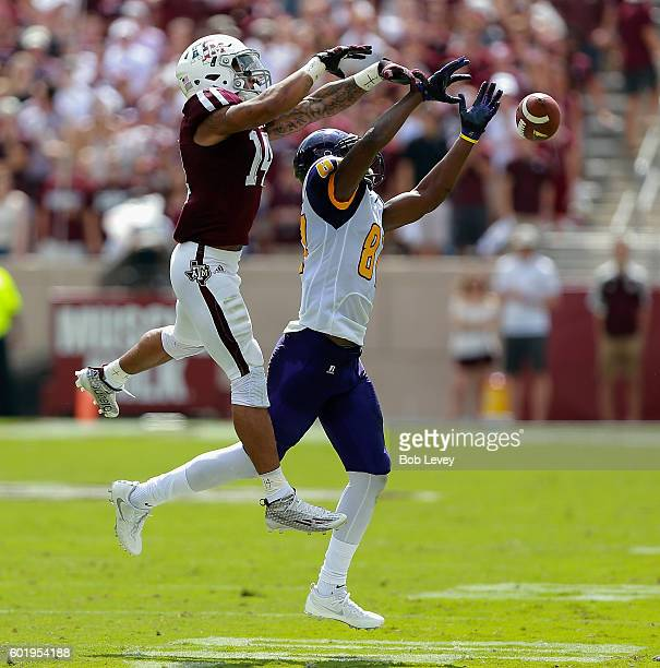 Justin Evans of the Texas AM Aggies deflects a pass intended for Demarquo Lastrappe of the Prairie View AM Panthers at Kyle Field on September 10...