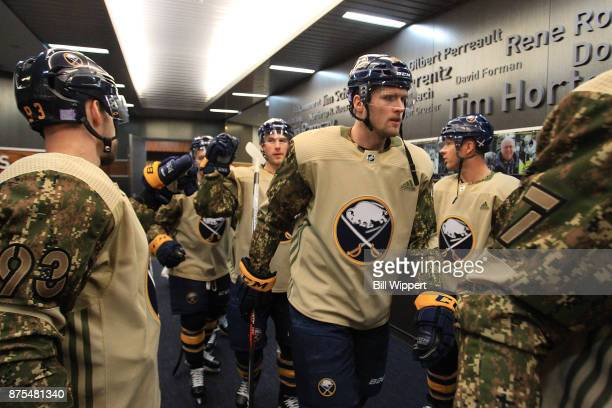Justin Falk of the Buffalo Sabres heads to the ice in a special jersey on Military Appreciation Night before an NHL game against the Florida Panthers...