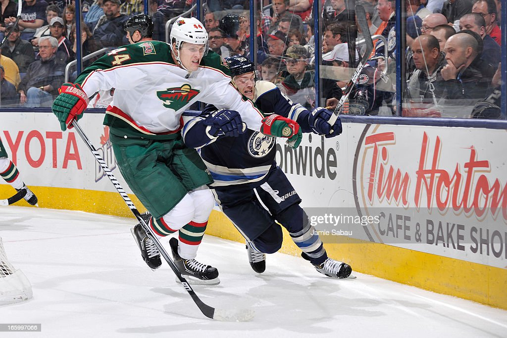 Justin Falk #44 of the Minnesota Wild and Mark Letestu #55 of the Columbus Blue Jackets battle for a loose puck during the third period on April 7, 2013 at Nationwide Arena in Columbus, Ohio. Minnesota defeated Columbus 3-0.