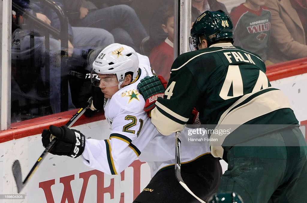 <a gi-track='captionPersonalityLinkClicked' href=/galleries/search?phrase=Justin+Falk&family=editorial&specificpeople=4324950 ng-click='$event.stopPropagation()'>Justin Falk</a> #44 of the Minnesota Wild checks <a gi-track='captionPersonalityLinkClicked' href=/galleries/search?phrase=Loui+Eriksson&family=editorial&specificpeople=2235241 ng-click='$event.stopPropagation()'>Loui Eriksson</a> #21 of the Dallas Stars into the boards during the first period on January 20, 2013 at Xcel Energy Center in St Paul, Minnesota. The Wild defeated the Stars 1-0.