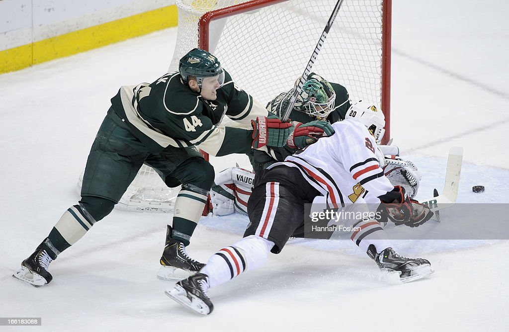 <a gi-track='captionPersonalityLinkClicked' href=/galleries/search?phrase=Justin+Falk&family=editorial&specificpeople=4324950 ng-click='$event.stopPropagation()'>Justin Falk</a> #44 of the Minnesota Wild looks on as teammate Niklas Backstrom #32 deflects the shot by <a gi-track='captionPersonalityLinkClicked' href=/galleries/search?phrase=Brandon+Saad&family=editorial&specificpeople=7128385 ng-click='$event.stopPropagation()'>Brandon Saad</a> #20 of the Chicago Blackhawks during the third period of the game on April 9, 2013 at Xcel Energy Center in St Paul, Minnesota. The Blackhawks defeated the Wild 1-0.