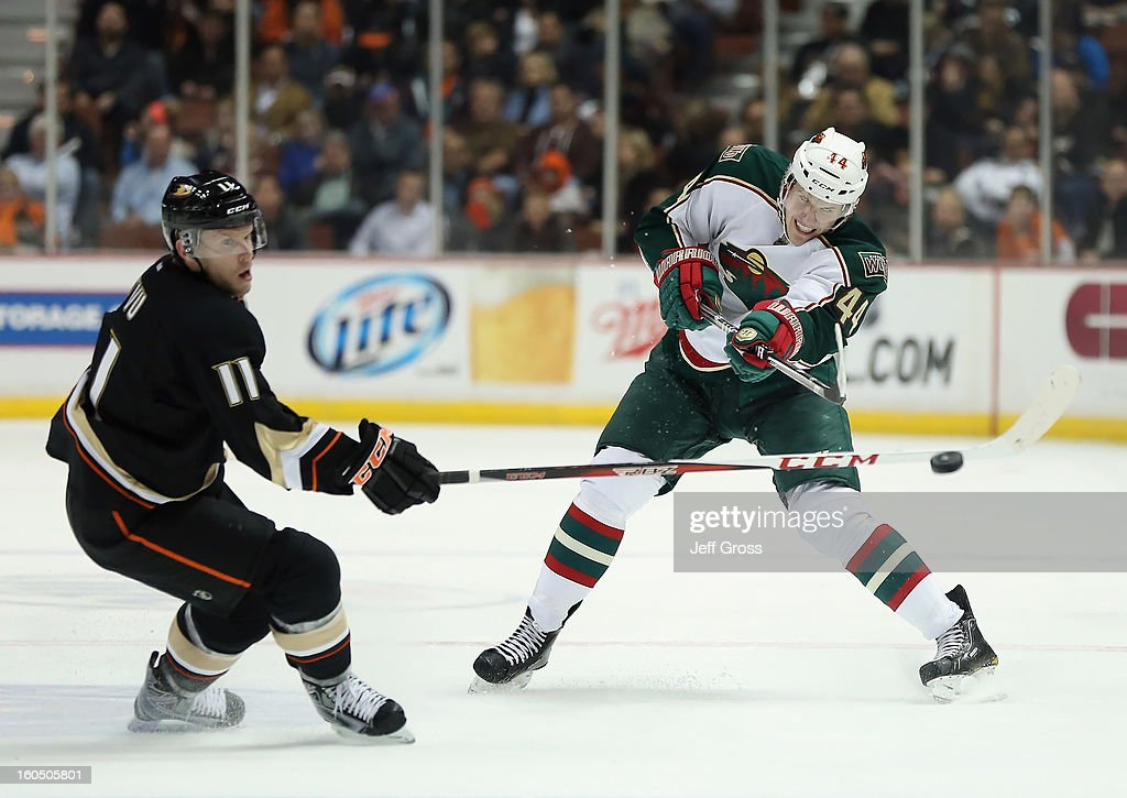 Justin Falk #44 of the Minnesota Wild shoots the puck past Saku Koivu #11 of the Anaheim Ducks in the second period at Honda Center on February 1, 2013 in Anaheim, California.