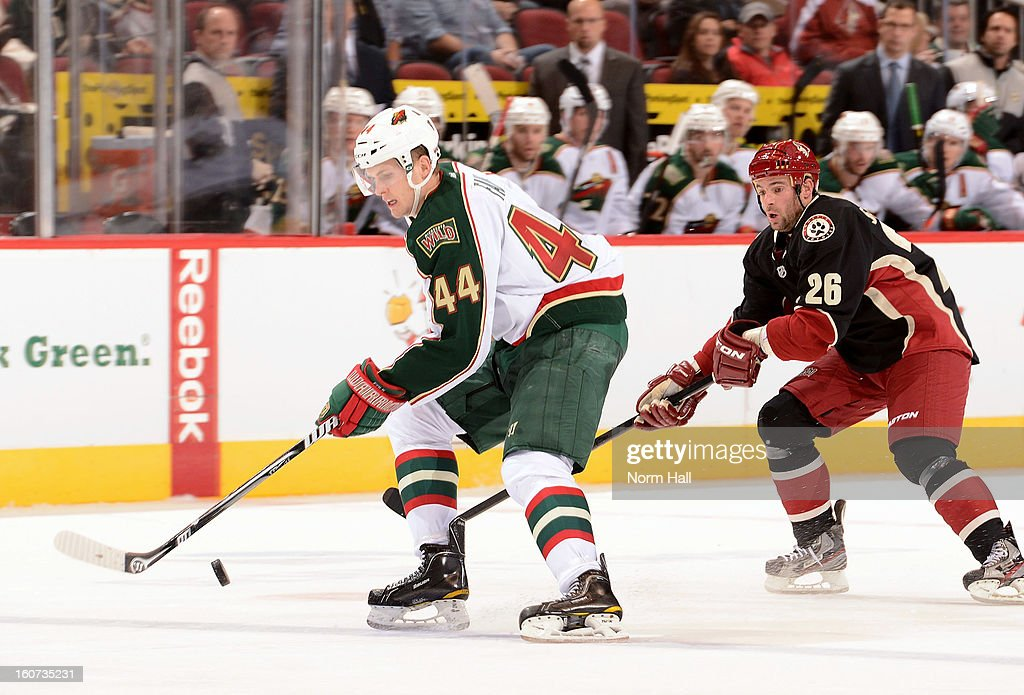 <a gi-track='captionPersonalityLinkClicked' href=/galleries/search?phrase=Justin+Falk&family=editorial&specificpeople=4324950 ng-click='$event.stopPropagation()'>Justin Falk</a> #44 of the Minnesota Wild skates the puck up ice past <a gi-track='captionPersonalityLinkClicked' href=/galleries/search?phrase=Steve+Sullivan&family=editorial&specificpeople=201723 ng-click='$event.stopPropagation()'>Steve Sullivan</a> #26 of the Phoenix Coyotes during the second period at Jobing.com Arena on February 4, 2013 in Glendale, Arizona.