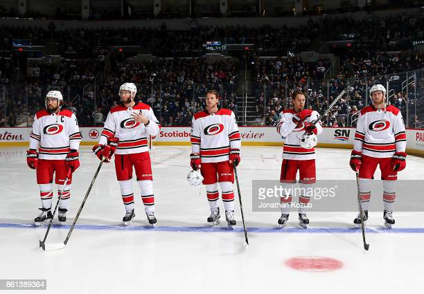 Justin Faulk Jordan Staal Elias Lindholm Sebastian Aho and Jaccob Slavin of the Carolina Hurricanes stand on the blueline prior to puck drop against...