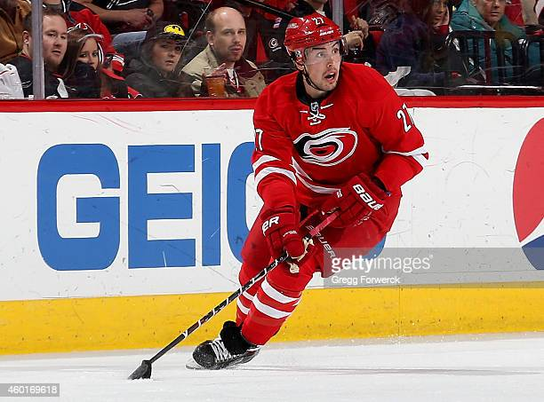 Justin Faulk of the Carolina Hurricanes carries the puck during an NHL game against the New Jersey Devils at PNC Arena on December 8 2014 in Raleigh...