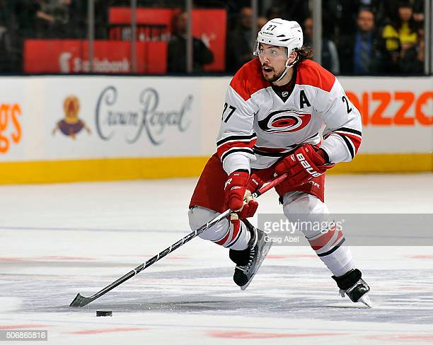 Justin Faulk of the Carolina Hurricanes carries the puck up ice against the Toronto Maple Leafs during game action on January 21 2016 at Air Canada...
