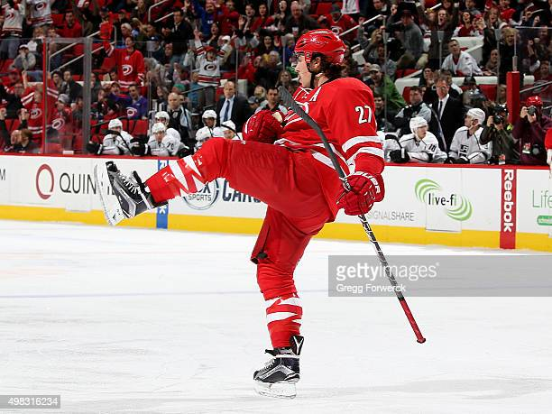 Justin Faulk of the Carolina Hurricanes celebrates after scoring during a NHL game against the Los Angeles Kings at PNC Arena on November 22 2015 in...