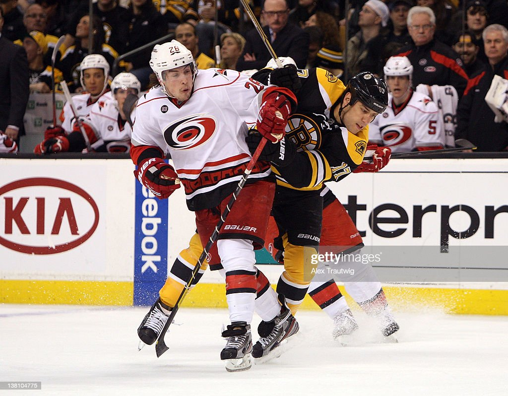 Justin Faulk #28 of the Carolina Hurricanes checks <a gi-track='captionPersonalityLinkClicked' href=/galleries/search?phrase=Milan+Lucic&family=editorial&specificpeople=537957 ng-click='$event.stopPropagation()'>Milan Lucic</a> #17 of the Boston Bruins at TD Garden on February 2, 2012 in Boston, Massachusetts. The Hurricanes defeated the Bruins 3-0.