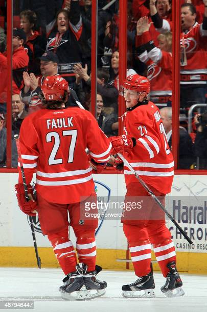 Justin Faulk of the Carolina Hurricanes congratulates Drayson Bowman on his secondperiod goal against the Montreal Canadiens during their NHL game at...