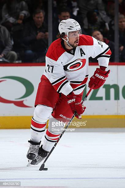 Justin Faulk of the Carolina Hurricanes controls the puck against the Colorado Avalanche at Pepsi Center on October 21 2015 in Denver Colorado The...