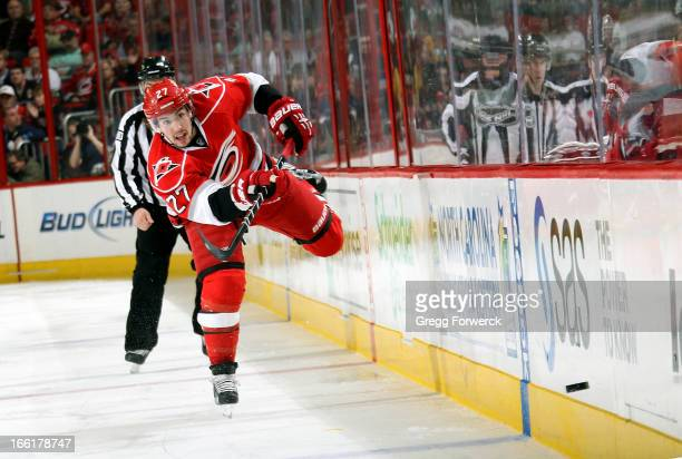 Justin Faulk of the Carolina Hurricanes dumps the puck during an NHL game against the Pittsburgh Penguins during their NHL game at PNC Arena on April...