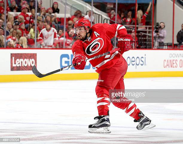 Justin Faulk of the Carolina Hurricanes fires a shot on net during a NHL game against the Detroit Red Wings at PNC Arena on October 10 2015 in...