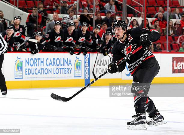 Justin Faulk of the Carolina Hurricanes fires a slap shot and scores as teammates watch from the bench Justin's game winner defeated the Arizona...