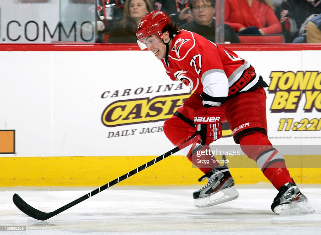 Justin Faulk #27 of the Carolina Hurricanes hustles down ice during an NHL game against the Buffalo Sabres at PNC Arena on January 24, 2013.
