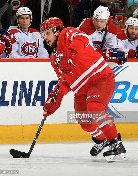 Justin Faulk of the Carolina Hurricanes looks to pass the puck during an NHL game against the Montreal Canadiens at PNC Arena on February 8 2014 in...