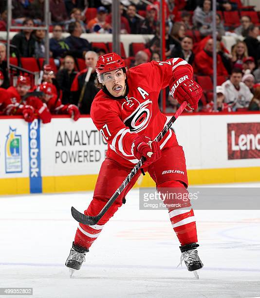 Justin Faulk of the Carolina Hurricanes passes the puck during a NHL game against the Edmonton Oilers at PNC Arena on November 25 2015 in Raleigh...