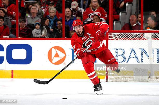 Justin Faulk of the Carolina Hurricanes passes the puck during an NHL game against the Chicago Blackhawks at PNC Arena on January 26 2016 in Raleigh...