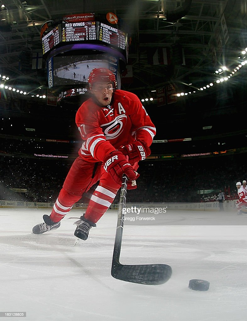 Justin Faulk #27 of the Carolina Hurricanes plays the puck near the boards of the during an NHL game against the Detroit Red Wings on October 4, 2013 at PNC Arena in Raleigh, North Carolina.