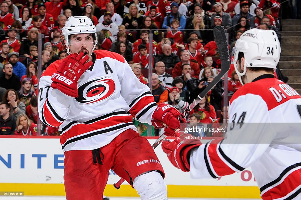 Justin Faulk #27 of the Carolina Hurricanes reacts after scoring against the Chicago Blackhawks in the second period of the NHL game at the United Center on December 27, 2015 in Chicago, Illinois.