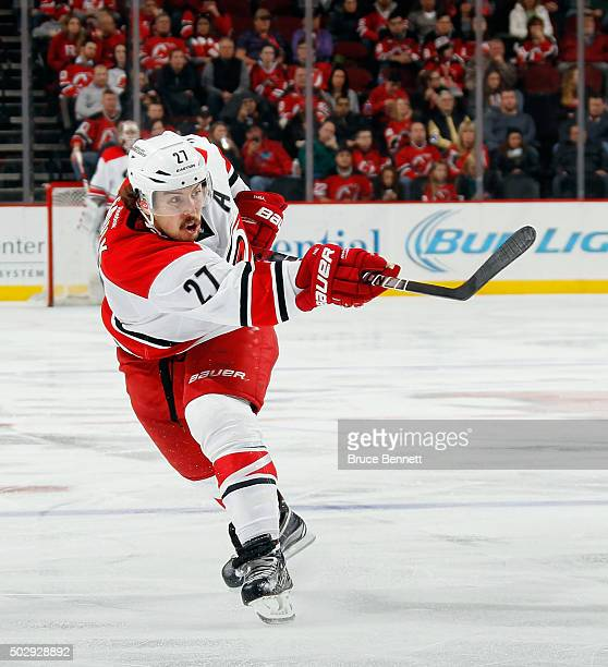 Justin Faulk of the Carolina Hurricanes skates against the New Jersey Devils at the Prudential Center on December 29 2015 in Newark New Jersey The...