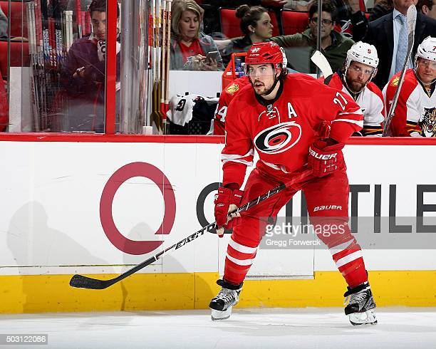 Justin Faulk of the Carolina Hurricanes skates for position along the boards during a NHL game against the Florida Panthers at PNC Arena on December...