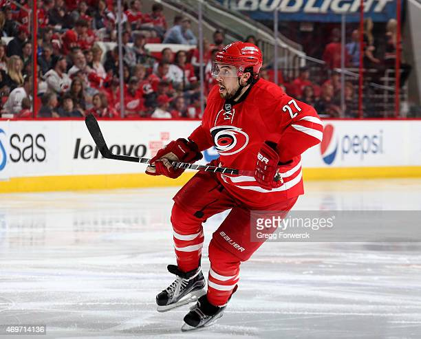 Justin Faulk of the Carolina Hurricanes skates for position on the ice during their NHL game against the Detroit Red Wings at PNC Arena on April 11...