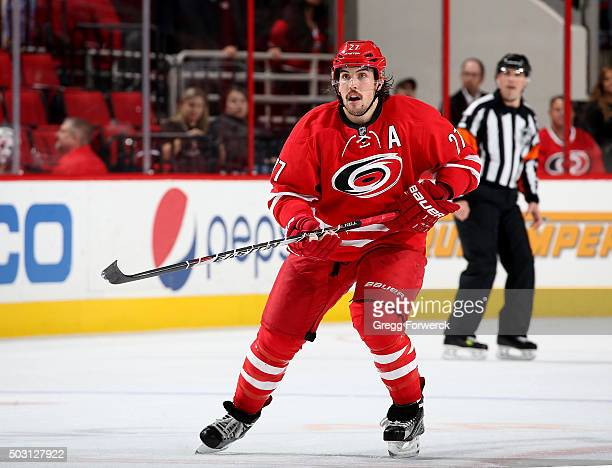 Justin Faulk of the Carolina Hurricanes skates for position on the ice during an NHL game against the New Jersey Devils at PNC Arena on December 26...