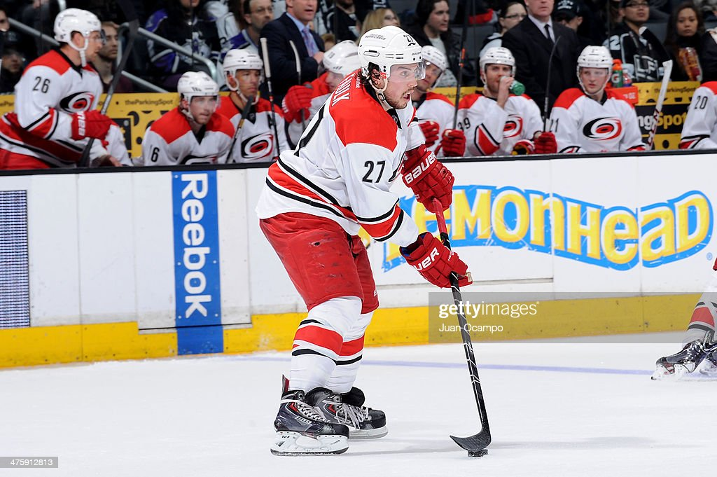 Justin Faulk #27 of the Carolina Hurricanes skates with the puck against the Los Angeles Kings at Staples Center on March 1, 2014 in Los Angeles, California.