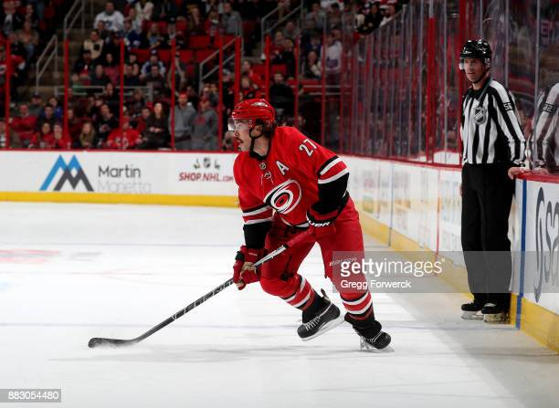 Justin Faulk of the Carolina Hurricanes skates with the puck along the blueline during an NHL game against the Toronto Maple Leafs on November 24...