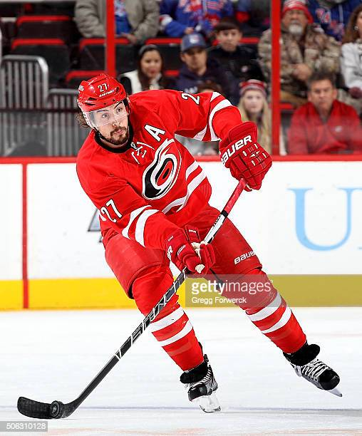 Justin Faulk of the Carolina Hurricanes skates witht the puck during an NHL game against the New York Rangers at PNC Arena on January 22 2016 in...