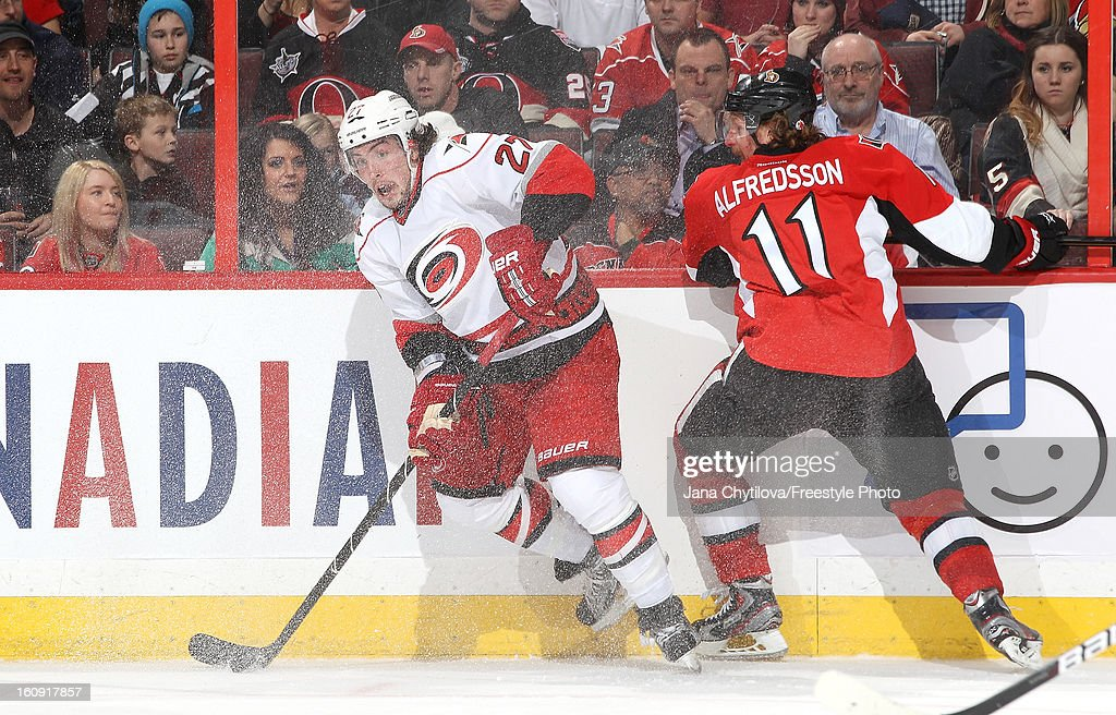 Justin Faulk #27 of the Carolina Hurricanes stickhandles the puck past <a gi-track='captionPersonalityLinkClicked' href=/galleries/search?phrase=Daniel+Alfredsson&family=editorial&specificpeople=201853 ng-click='$event.stopPropagation()'>Daniel Alfredsson</a> #11 of the Ottawa Senators, during an NHL game at Scotiabank Place on February 7, 2013 in Ottawa, Ontario, Canada.