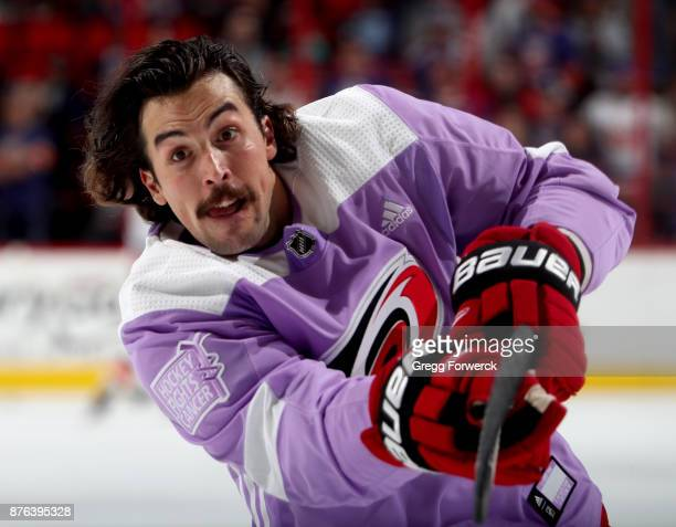 Justin Faulk of the Carolina Hurricanes wears the Hockey Fights Cancer jersey during warm up prior to an NHL game against the New York Islanders on...