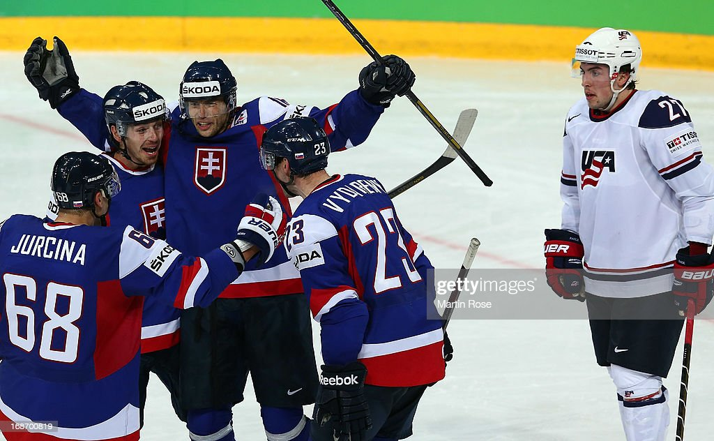 Justin Faulk (#27) of USA looks dejected while Tomas Zaborsky (L) and Roman Kukumberg (C) of Slovakia celebrate their 3rd during the IIHF World Championship group H match between Slovakia and USA at Hartwall Areena on May 14, 2013 in Helsinki, Finland.