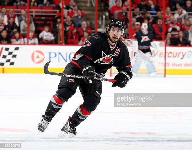 Justin Faullk of the Carolina Hurricanes skates for position on the ice during a NHL game against the Colorado Avalanche at PNC Arena on October 30...