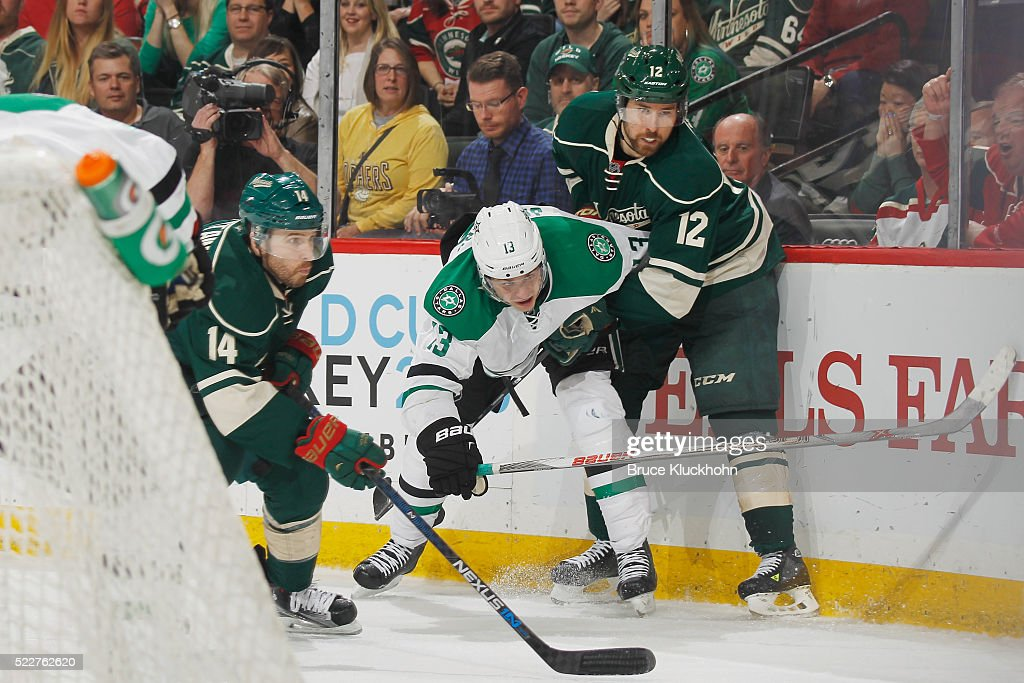 Justin Fontaine #14 and David Jones #12 of the Minnesota Wild battle for the puck with Mattias Janmark #13 of the Dallas Stars in Game Four of the Western Conference First Round during the 2016 NHL Stanley Cup Playoffs on April 20, 2016 at the Xcel Energy Center in St. Paul, Minnesota.