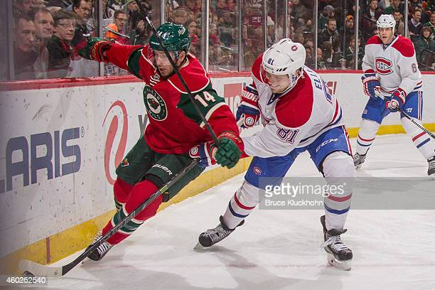 Justin Fontaine of the Minnesota Wild and Lars Eller of the Montreal Canadiens battle for the puck during the game on December 3 2014 at the Xcel...