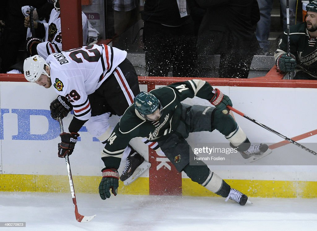 <a gi-track='captionPersonalityLinkClicked' href=/galleries/search?phrase=Justin+Fontaine&family=editorial&specificpeople=8312194 ng-click='$event.stopPropagation()'>Justin Fontaine</a> #14 of the Minnesota Wild checks <a gi-track='captionPersonalityLinkClicked' href=/galleries/search?phrase=Bryan+Bickell&family=editorial&specificpeople=241498 ng-click='$event.stopPropagation()'>Bryan Bickell</a> #29 of the Chicago Blackhawks into the boards during overtime in Game Six of the Second Round of the 2014 NHL Stanley Cup Playoffs on May 13, 2014 at Xcel Energy Center in St Paul, Minnesota. The Blackhawks defeated the Wild 2-1 in overtime.