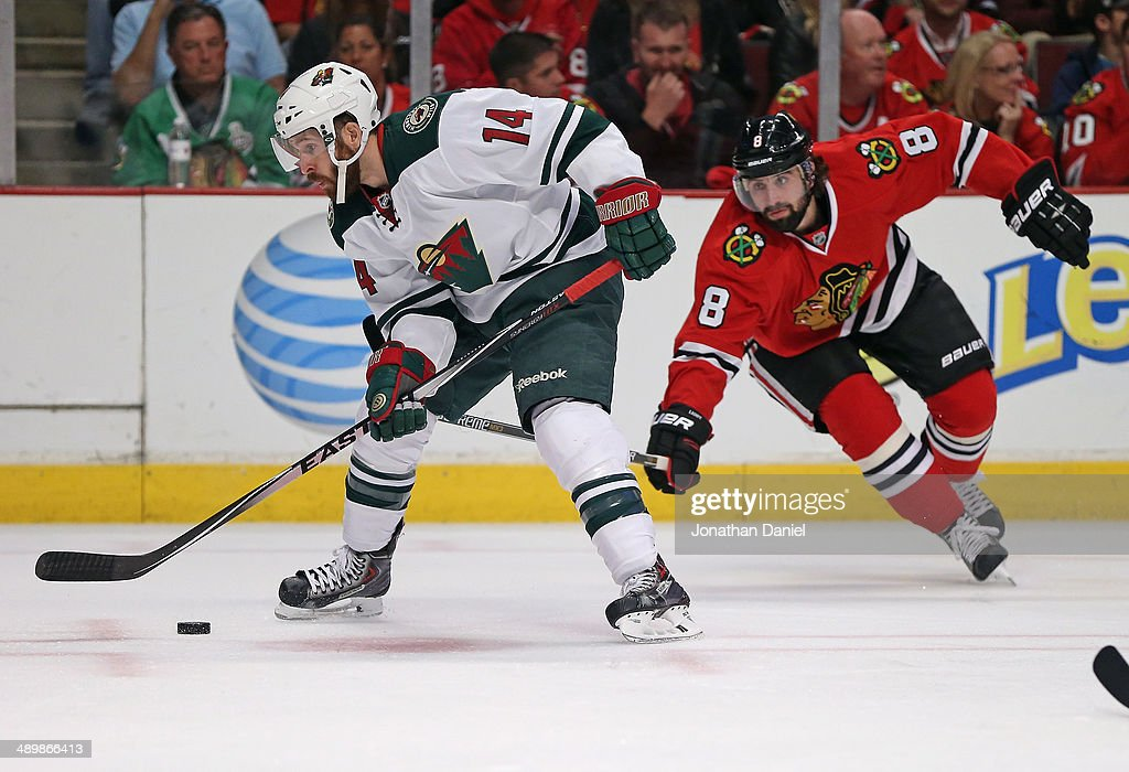 <a gi-track='captionPersonalityLinkClicked' href=/galleries/search?phrase=Justin+Fontaine&family=editorial&specificpeople=8312194 ng-click='$event.stopPropagation()'>Justin Fontaine</a> #14 of the Minnesota Wild controls the puck under pressure from <a gi-track='captionPersonalityLinkClicked' href=/galleries/search?phrase=Nick+Leddy&family=editorial&specificpeople=5894600 ng-click='$event.stopPropagation()'>Nick Leddy</a> #8 of the Chicago Blackhawks in Game Five of the Second Round of the 2014 NHL Stanley Cup Playoffs at the United Center on May 11, 2014 in Chicago, Illinois. The Blackhawks defeated the Wild 2-1.