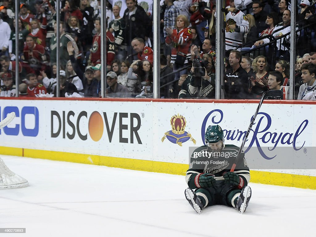 Justin Fontaine #14 of the Minnesota Wild reacts after having a shot stopped by Corey Crawford #50 of the Chicago Blackhawks during the second period in Game Six of the Second Round of the 2014 NHL Stanley Cup Playoffs on May 13, 2014 at Xcel Energy Center in St Paul, Minnesota. The Blackhawks defeated the Wild 2-1 in overtime.