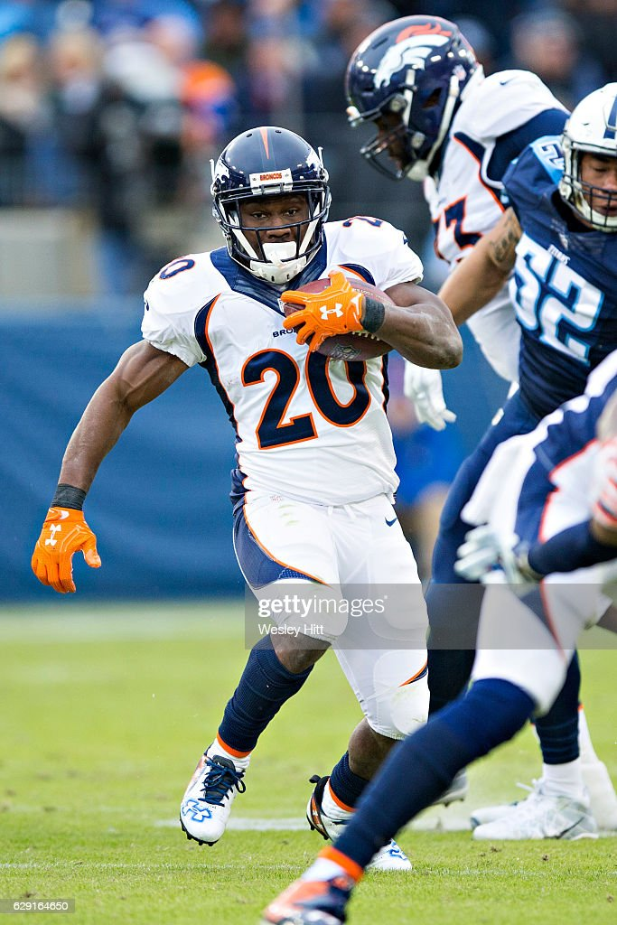 Justin Forsett #20 of the Denver Broncos runs the ball during a game against the Tennessee Titans at Nissan Stadium on December 11, 2016 in Nashville, Tennessee. The Titans defeated the Broncos 13-10.