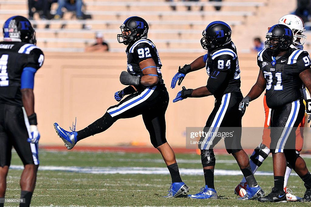 Justin Foxx #92 of the Duke Blue Devils reacts following a defensive stop against the Miami Hurricanes at Wallace Wade Stadium on November 24, 2012 in Durham, North Carolina.