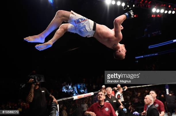 Justin Gaethje celebrates by doing a backflip off the Octagon after defeating Michael Johnson in their lightweight bout during The Ultimate Fighter...