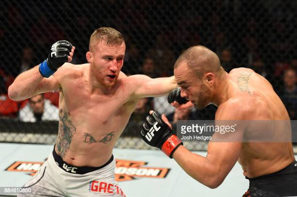 Justin Gaethje punches Eddie Alvarez in their lightweight bout during the UFC 218 event inside Little Caesars Arena on December 02 2017 in Detroit...