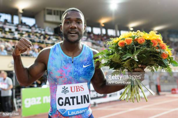 US Justin Gatlin celebrates after winin ghte 100m men event during the Diamond League athletics meeting Athletissima in Lausanne on July 6 2017 / AFP...